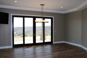 Bonus room with floor to ceiling windows by Braemar