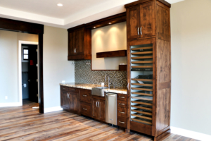 Mini bar, mini fridge, and wine rack in a bonus room by Braemar