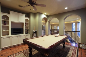 A pool table in a home's bonus room
