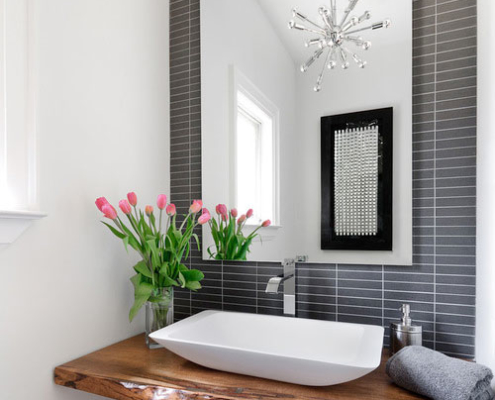 Powder room statement wall with patterned wallpaper